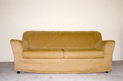 Couch 1. Picture of a couch in front of a blank wall Stock Photos