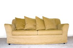 Couch 2. Picture of a couch with four pillows, in front of an empty white wall Stock Images