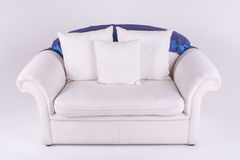 Couch. A huge couch with three cushions and blue throw Royalty Free Stock Photography