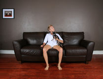 On the couch Stock Images
