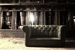 Couch. In an abandoned industrial background Royalty Free Stock Image