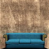 Couch Against Grunged Wall Royalty Free Stock Image