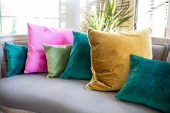 Couch assorted pillows royalty free stock photos