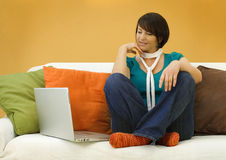 Casual Woman on Sofa with Computer Stock Photo