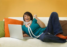 Happy Woman on Sofa with Laptop Royalty Free Stock Photos