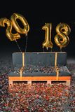 Couch with confetti and new year balloons Stock Photos