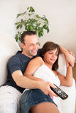 Couch couple remote Royalty Free Stock Photography