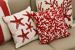 Couch with designer cushions Stock Photos