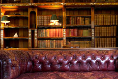 Couch in library Stock Images