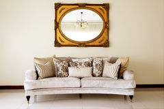 Couch with Mirror. Modern Couch with Cushions and Antique Mirror Stock Photography