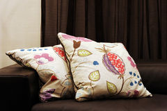 Couch with patterned cushions Royalty Free Stock Photos