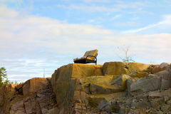 A couch perched on a cliff in the northwest territories Royalty Free Stock Image