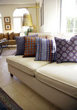 Couch with pillows. Living room interior with handmade silk Bedouin pillows and couch Stock Images