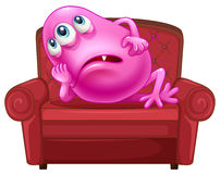 A couch with a pink monster Stock Photography