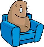 Couch Potato. A potato sitting on a small couch Stock Images