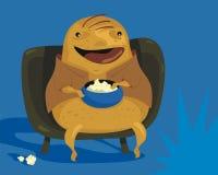 Couch Potato. Happy couch potato cartoon enjoying TV programs Royalty Free Stock Photo