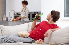 Couch potato doesn't help wife Stock Photos