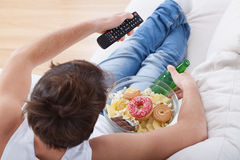 Couch potato watching match Stock Photos