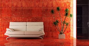 Couch into the red interior Royalty Free Stock Photo