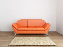 Couch to face a blank wall Stock Photo