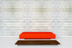 Couch on white brick wall Stock Photo