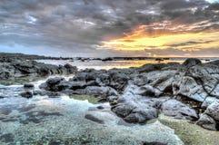 Coucher de soleil skjul mest ouest île de la Réunion Royaltyfria Bilder