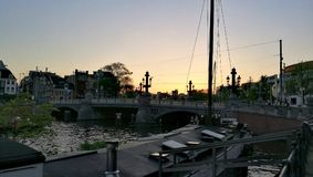Coucher du soleil à Amsterdam Photos stock
