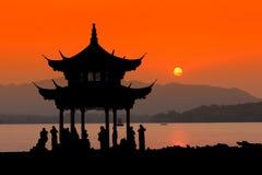 Coucher du soleil à Hangzhou Photographie stock libre de droits
