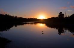 Coucher du soleil à l'étang d'Eco Photographie stock