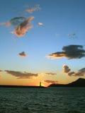 Coucher du soleil à la mer Photos stock
