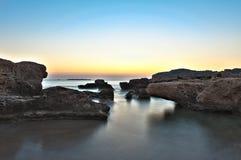 Coucher du soleil à la mer Photographie stock libre de droits