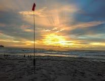 Coucher du soleil à la plage Photographie stock