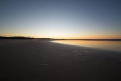 Coucher du soleil à la plage Photo libre de droits