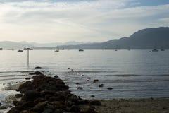 Coucher du soleil à la plage de Kitsilano à Vancouver Photos stock