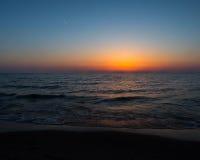 Coucher du soleil à la plage ovale Saugatuck Photographie stock