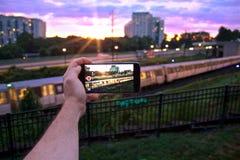Coucher du soleil à la station de train Photos stock