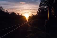 Coucher du soleil au chemin de fer Photo stock
