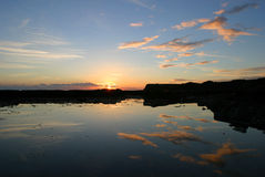 Coucher du soleil au compartiment de Kimmeridge, Dorset Images stock