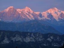 Coucher du soleil au-dessus d'Eiger Mönch et de Jungfrau Photos stock