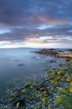 Coucher du soleil au-dessus de compartiment de Dublin Photographie stock libre de droits