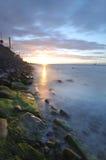 Coucher du soleil au-dessus de compartiment de Dublin Photo stock