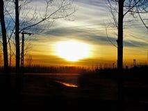 Coucher du soleil au-dessus de The Creek Photo stock