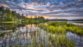 Coucher du soleil au-dessus de lac Nordvattnet dans Hokensas Images libres de droits