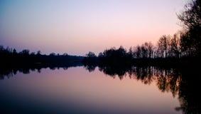 Coucher du soleil au-dessus de lac Perach Images stock