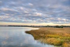 Coucher du soleil au-dessus de marais Photo stock