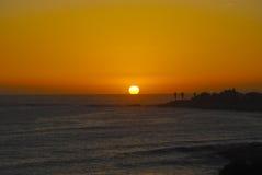 Coucher du soleil au-dessus de mer, Taghazout, Maroc Photo libre de droits
