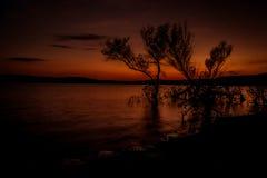 Coucher du soleil au-dessus du lac en automne Photos libres de droits