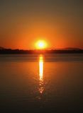 Coucher du soleil au-dessus du Mekong Image libre de droits