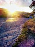 Coucher du soleil au-dessus du RO DN14 photos stock