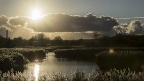 Coucher du soleil au-dessus du parc de pays de vue de Wirral le Mersey Photo libre de droits